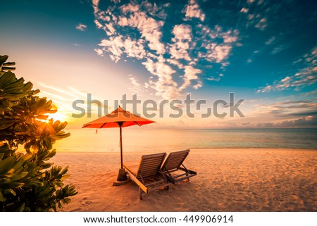 Beautiful beach background for summer travel with sun,coconut tree and beach wooden bed on sand with beautiful blue sea and blue sky. Summer mood sun beach background concept. #449906914