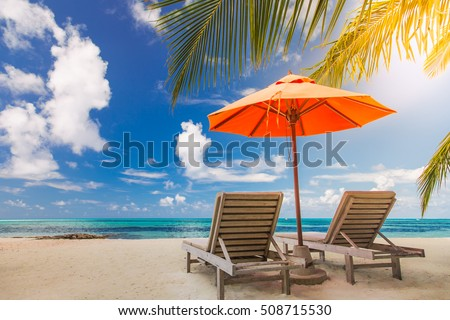Beautiful beach background for summer travel with sun,coconut tree and beach wooden bed on sand with beautiful blue sea and blue sky. Summer mood sun beach background concept. #508715530