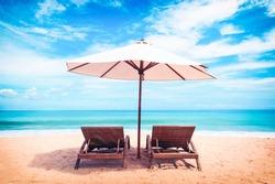 Beautiful beach. Chairs on the  sandy beach near the sea. Summer holiday and vacation concept. Tropical beach.