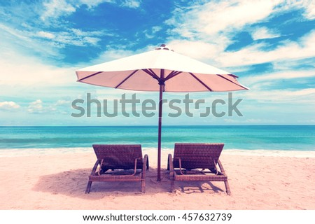 Beautiful beach. Chairs on the  sandy beach near the sea. Summer holiday and vacation concept. #457632739