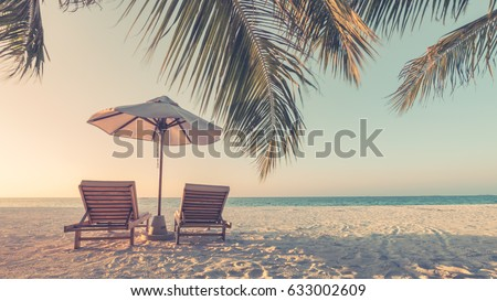 Beautiful beach. Chairs on the sandy beach near the sea. Summer holiday and vacation concept. Inspirational tropical beach. Tranquil scenery, relaxing beach, tropical landscape design. Moody landscape #633002609