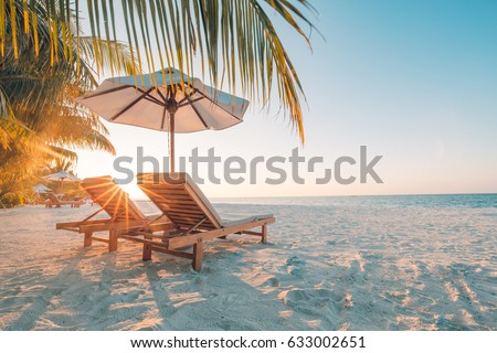 Beautiful beach. Chairs on the sandy beach near the sea. Summer holiday and vacation concept. Inspirational tropical beach. Tranquil scenery, relaxing beach, tropical landscape design. Moody landscape #633002651