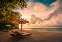 Beautiful beach. Chairs on the sandy beach near the sea. Summer holiday and vacation concept for tourism. Inspirational tropical landscape. Tranquil scenery, relaxing beach, tropical landscape design
