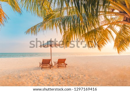 Beautiful beach. Chairs on the sandy beach near the sea. Summer holiday and vacation concept for tourism. Tranquil scenery, relaxing beach, wonderful tropical landscape design. Boost up color process #1297169416