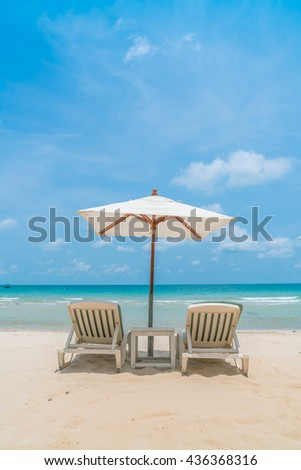 Beautiful beach chairs with umbrella on tropical white sand beach #436368316
