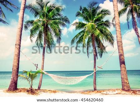 stock photo beautiful beach hammock between two palm trees on the beach holiday and vacation concept 454620460 - Каталог — Фотообои «Море, пляж»