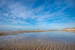 Beautiful Beach Of Domburg With Waterreflections And Wooden Pillars - Zeeland