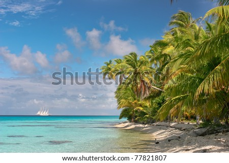 Beautiful beach of Fakarava with the ship in the background, French Polynesia