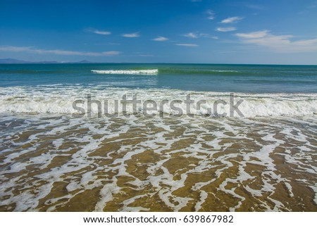 beautiful beach, on the sand roll frothy waves #639867982