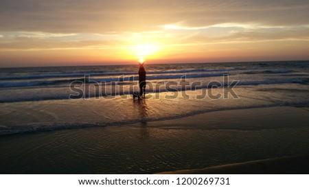beautiful beach sunset #1200269731