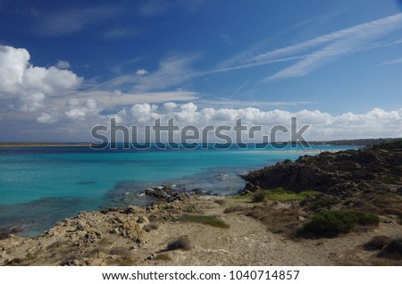 Beautiful beach with amazing clouds on the sky. Sardinia island. Italy.