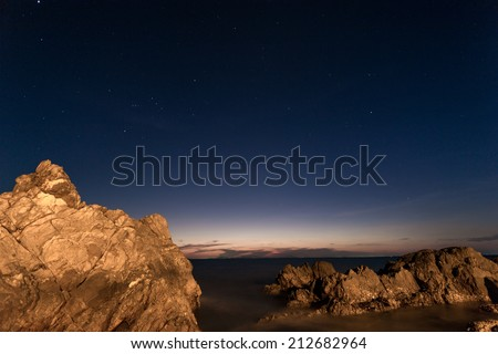 beautiful beach with night sky and stars