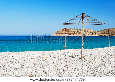 Beautiful beach with turquoise water and white pebbles. Plaka village, East coast of Crete island, Greece.