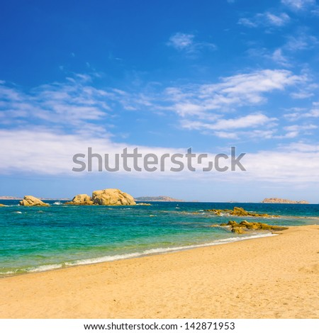 beautiful beach with turquoise water under blue  sky