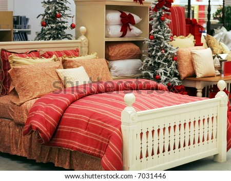 beautiful bed with autumn colored linens and holiday decorations