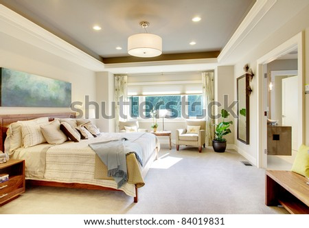 Beautiful Bedroom Interior in New Luxury Home - stock photo