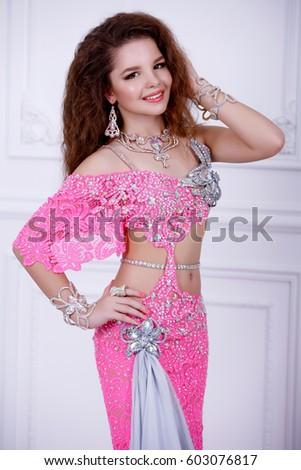 e3d16626a1d1 Beautiful Belly Dance teenage girl in pink baladi costume traditional  egiptian dancing wear. Bellydancer artist