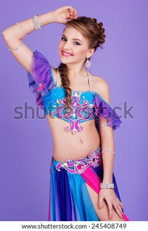 7a2e392ab3d93 Teen girl in belly dancer costume dancing, isolated on white ...