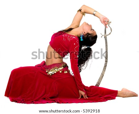 beautiful belly dancer with a spade over a white background