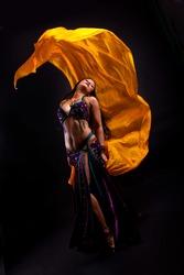 Beautiful bellydancer tossing veil