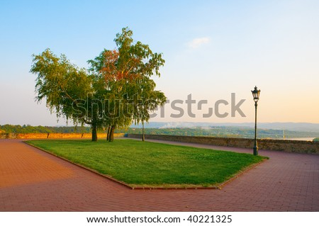 Beautiful belvedere decorated with trees and grass from which you can see all the town.