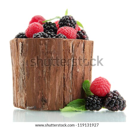beautiful berries with leaves in wooden vase isolated on white