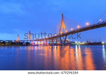 Beautiful Big Bhumibol Bridge with lighting reflections in night time / Big bridge at the river #679296184