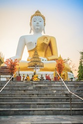 Beautiful big buddha image at Wat Phra That Doi Kham. Chiang Mai, Thailand. Wat Phra That Doi Kham (Wat Doi Kham or the Golden temple) is located at the top of a hill to the south west of the city.