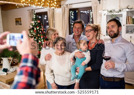 Beautiful big family celebrating Christmat together being photog
