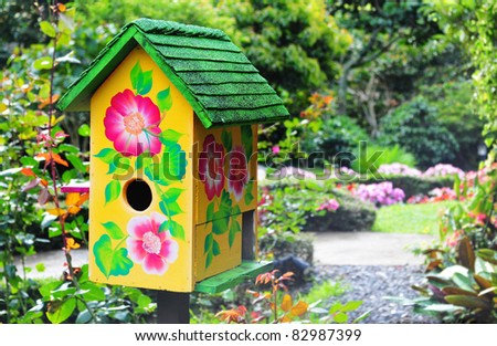 Beautiful bird house in a lush garden