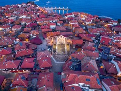 Beautiful bird's-eye night view of the old town of Nessebar, the Black Sea, Sunny Beach resort and mountains, Bulgaria.. High-altitude panoramic drone shot