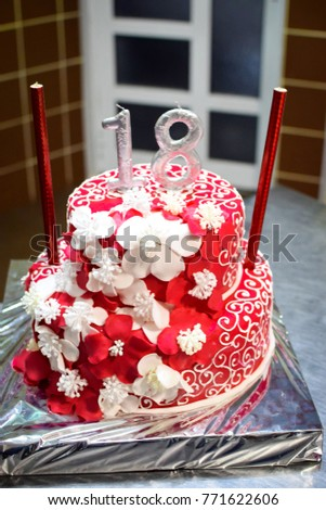 beautiful birthday cake with silver candles number 18 close up