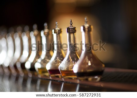 Beautiful Bitters bottles lined up on bar, shot with a short depth of field.