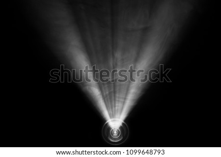 beautiful black and white color wide lens projector with light beam for movie and cinema at night . smoke texture spotlight . screening for multimedia . abstract background .
