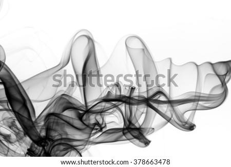 beautiful black and white smoke swirls over white background. fire design #378663478