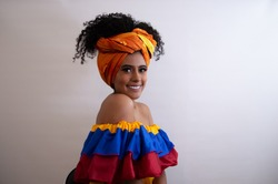 Beautiful Black Colombian Woman, Palenquera Colombiana. Tipical colombian dress. White Background