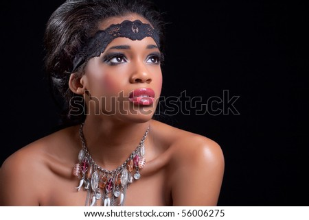 Beautiful black girl, isolated on black background