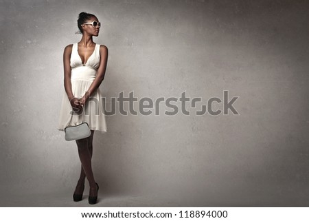 Beautiful black girl with a white dress posing - stock photo
