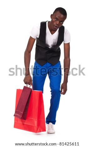 beautiful black man holding shopping bags and feeling tired