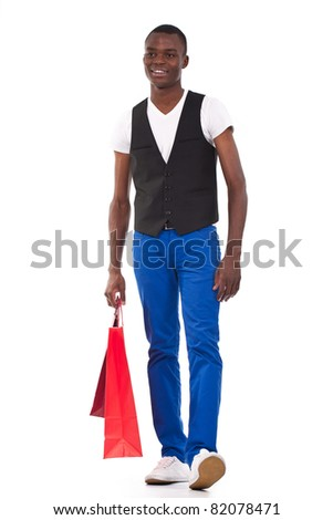 beautiful black man holding shopping bags and smiling