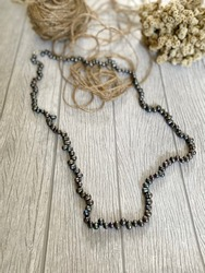 Beautiful Black Pearl necklace  on a wooden background. It is a Pearls jewellery from Lombok, Nusa Tenggara Barat Indonesia. Blurred background.