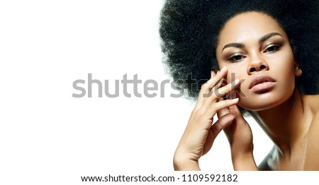"Beautiful black-skinned girl on a white background with smooth skin, bright make-up and a lush hair style in the style of ""Afro"". #1109592182"