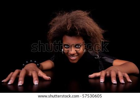 beautiful black  woman, isolated on black background.studio shot.