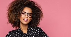 Beautiful black woman model wear glasses and black shirt in peas