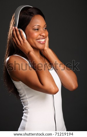 Beautiful black woman music fan happy smile