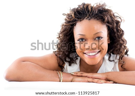 Beautiful black woman smiling - isolated over a white background