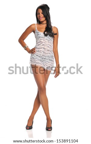 Beautiful black woman wearing a short dress and high heels isolated on a white background
