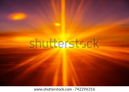 Beautiful blazing sunrise landscape above clouds. View from aircraft. Sunset and sunrise concept background. #742296316