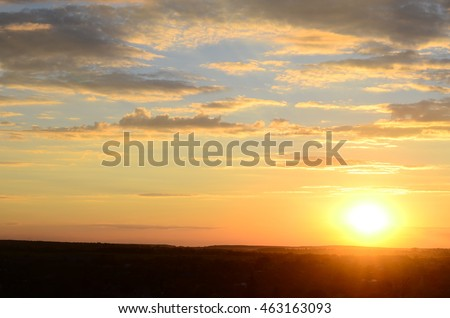 Beautiful blazing sunset landscape at black sea and orange sky above it with awesome sun golden reflection on calm waves as a background. Amazing summer sunset view on the beach. #463163093