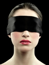 beautiful blindfolded girl on black